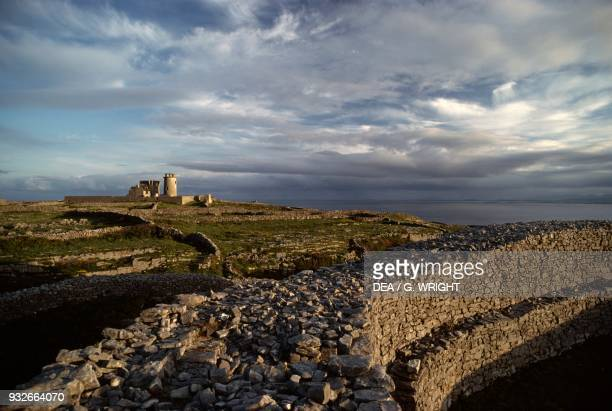View of the ruins of the lighthouse and the watchtower from Dun Eochla Inishmore Aran Islands Ireland