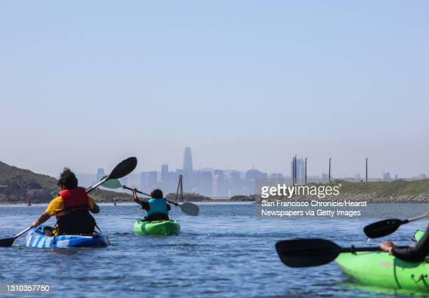 View of the San Francisco skyline greets Outdoor Afro kayaking participants as they paddle their boats from Marina Bay Yacht Harbor on Saturday,...