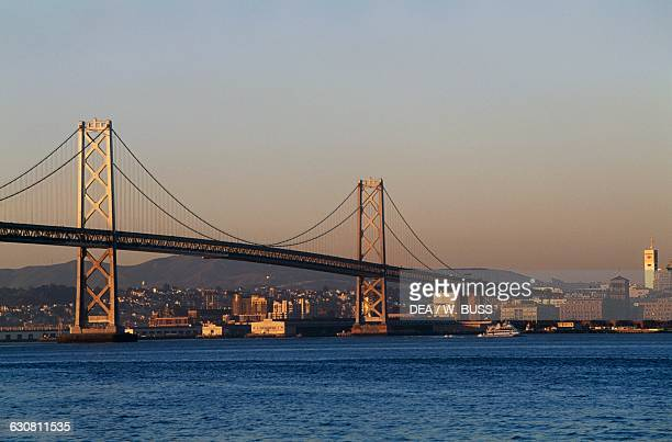 View of the San FranciscoOakland Bay Bridge from Yerba Buena Island at sunset San Francisco California United States of America