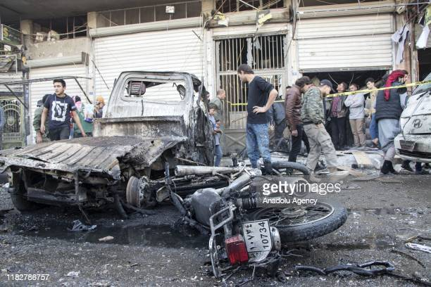 A view of the scene after the attacks came from two bombladen vehicles in alBab district in Syria on November 16 2019 At least 10 civilians were...