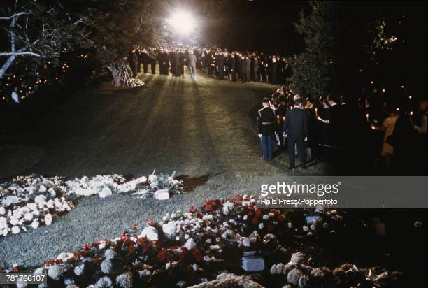 View of the scene with mourners lining the route prior to the arrival of the casket containing the body of assassinated Senator Robert F Kennedy at...
