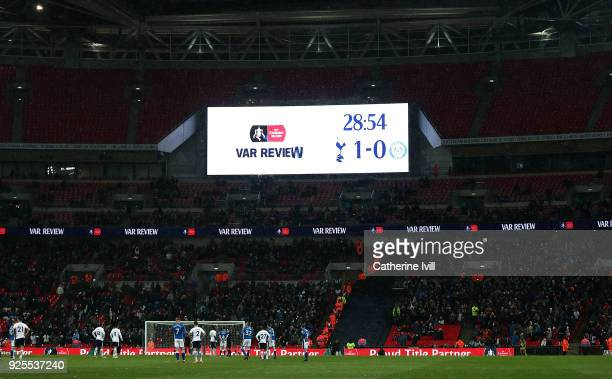 A view of the scoreboard as a decision is reviewed by VAR during The Emirates FA Cup Fifth Round Replay match between Tottenham Hotspur and Rochdale...