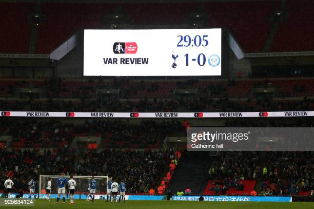 A view of the scoreboard as a decision is reviewed by VAR during The Emirates FA Cup Fifth Round Replay between Tottenham Hotspur and Rochdale on...