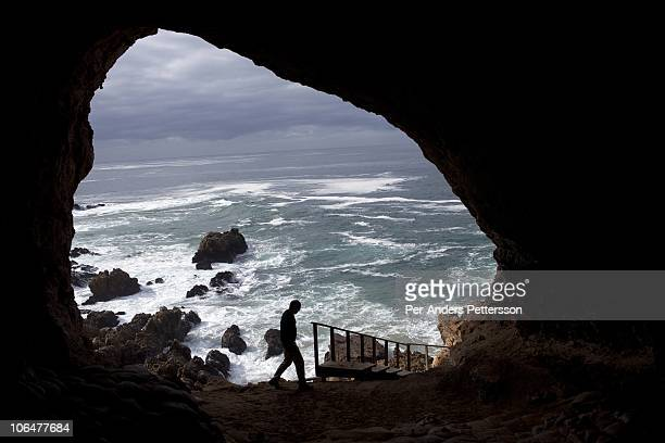 A view of the sea and rocks from inside a cave called PP13B on May 26 at Pinnacle Point near Mossel Bay South Africa The cave sheltered humans...
