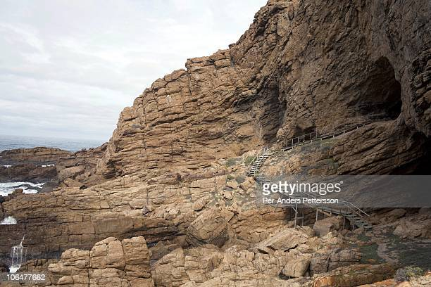 A view of the sea and rocks from outside a cave called PP13B on May 26 at Pinnacle Point near Mossel Bay South Africa The cave sheltered humans...