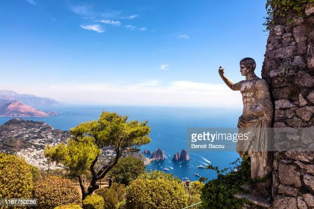 view of the sea and the statue of the august emperor, from the heights of mount solaro, anacapri, capri island, naples area, italy - capri stock pictures, royalty-free photos & images