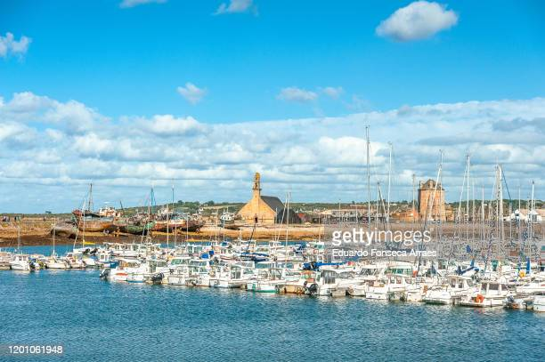 view of the sea, camaret bay, boats and harbor/marina against a sunny clear blue sky. - camaret sur mer photos et images de collection