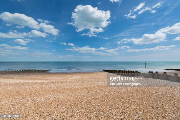 view of the sea from a beach - day stock pictures, royalty-free photos & images