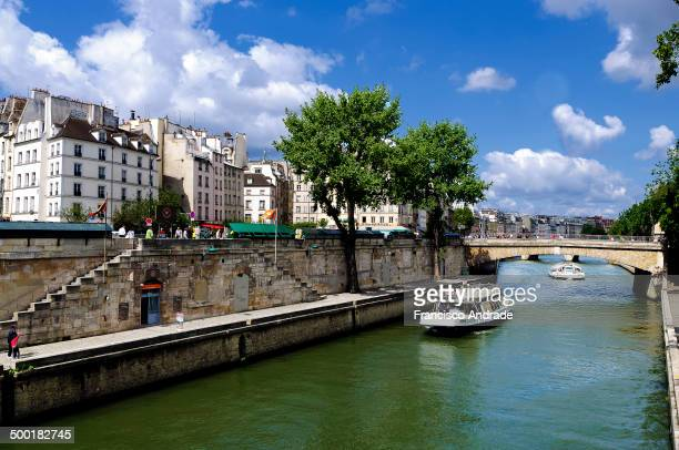 CONTENT] View of the Seine and the Petit Pont linking the quai de Montebello and quai SaintMichel in Paris France
