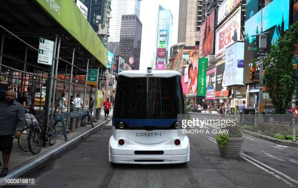 A view of the selfdriving shuttle is seen in Times Square July 17 2018 in New York as COAST Autonomous hosts a COAST Autonomous P1 selfdriving...