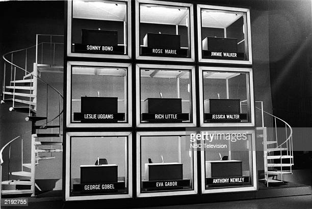 View of the set of the game show 'Hollywood Squares' with empty desks and name tags for the celebrity panelists 1970s