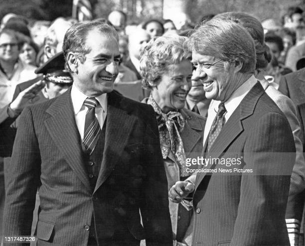 View of the Shah of Iran Mohammed Reza Pahlavi and US President Jimmy Carter as they share a smile during a State Visit on the South Lawn of the...