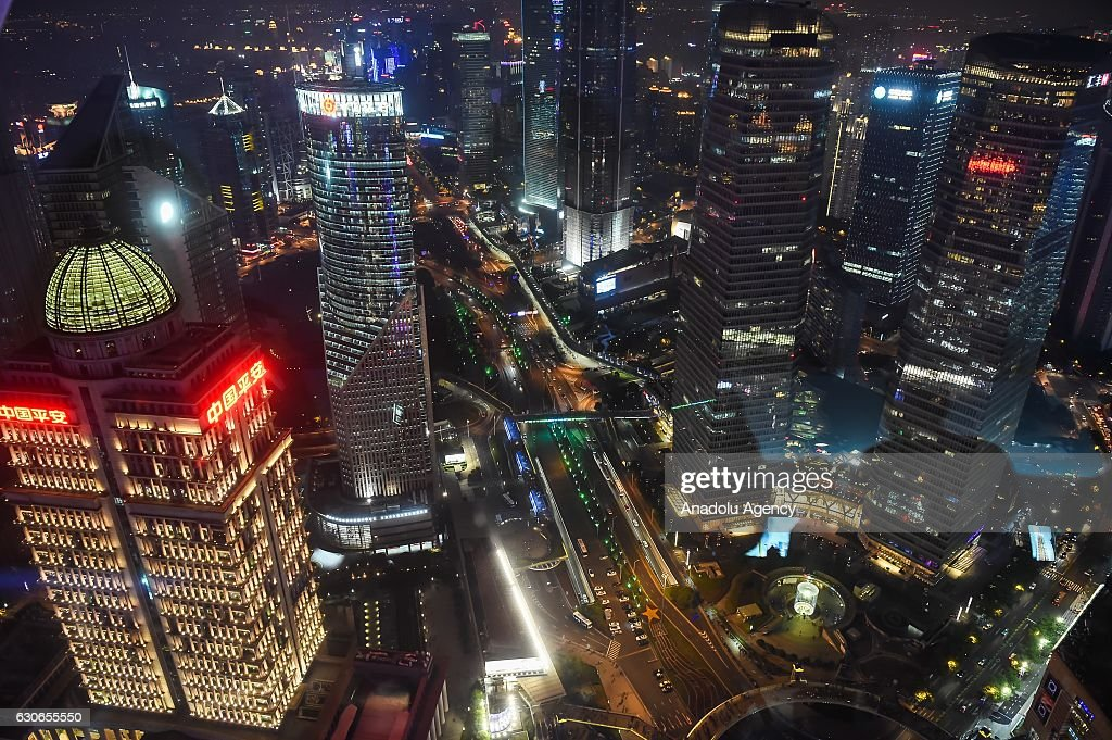 A view of the Shanghai city from inside the Transparent Observatory in Shanghai, China on December 29, 2016. The Transparent Observatory is located in Shanghai Oriental Pearl, it composed of 24 groups of transparent glass laminated glass,visitors can walk on it.