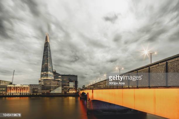view of the shard across the river thames at dusk, city of london, england, uk - image stock pictures, royalty-free photos & images