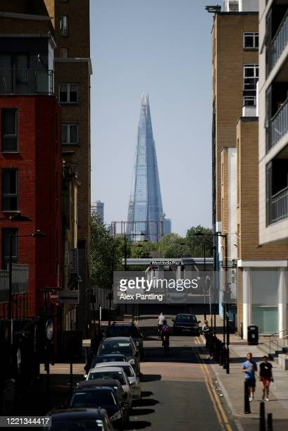 A view of the Shard down a street in Canary Wharf on April 26 2020 in London England The 40th London Marathon was due to take place today with...