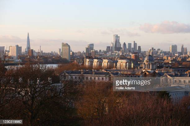 View of The Shard skyscraper and City of London skyline from the top of Greenwich Park on December 27, 2020 in London, United Kingdom. Last week, the...