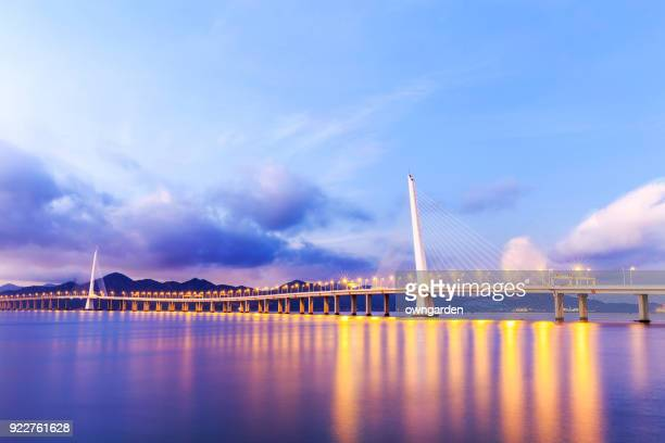 view of the shenzhen bay bridge - shenzhen stock pictures, royalty-free photos & images