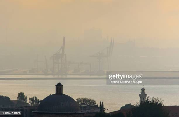 view of the shipyard in the morning fog on the asian side of istanbul - nikitina stock pictures, royalty-free photos & images
