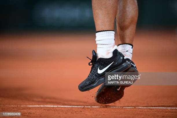 View of the shoes of Spain's Rafael Nadal as he plays against Italy's Jannik Sinner during their men's singles quarter-final tennis match on Day 10...