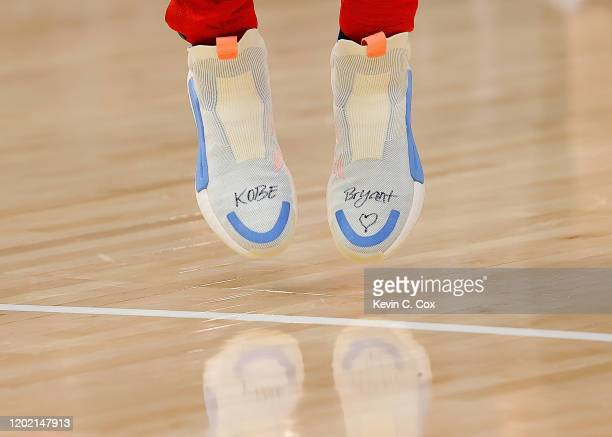 A view of the shoes worn by Trae Young of the Atlanta Hawks with Kobe Bryant's name written on them in his memory prior to facing the Washington...
