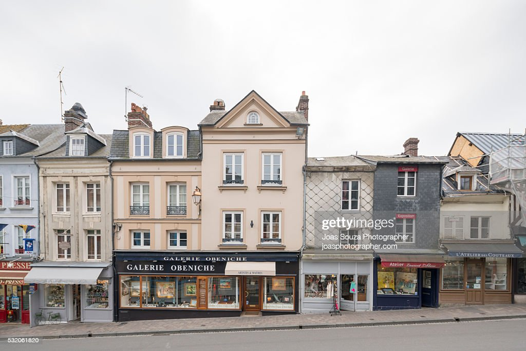View of the shops and beautiful old houses of the town of Honfleur, France. : Stock Photo