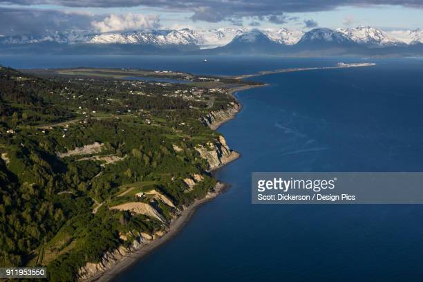 view of the shoreline of kachemak bay with the kenai mountains in the distance - kachemak bay stock pictures, royalty-free photos & images