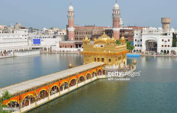 View of the Sikh shrine Golden Temple as Sikh devotees pay their respects on the eve of 413rd anniversary of the installation of the Guru Granth...