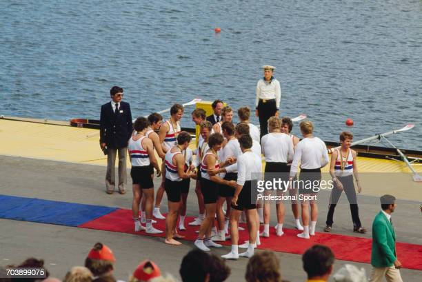 View of the silver medal winning Great Britain men's eights rowing team pictured being congratulated by the gold medal winning rowing team of East...