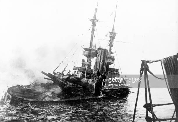 View of the sinking of the Royal Navy battleship HMS Irresistible during the Dardanelles campaign World War I May 4 1915