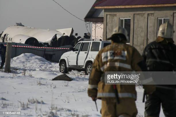 A view of the site of a passenger plane crash outside Almaty on December 27 2019 Some 12 people died on December 27 2019 and dozens were reported...