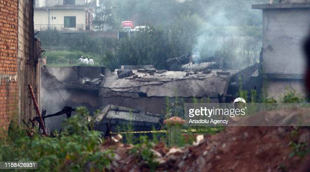 View of the site of a plane crash an Rawalpindi, Pakistan on July 30, 2019. Fifteen people were killed when a Pakistan Aviation aircraft crashed into...