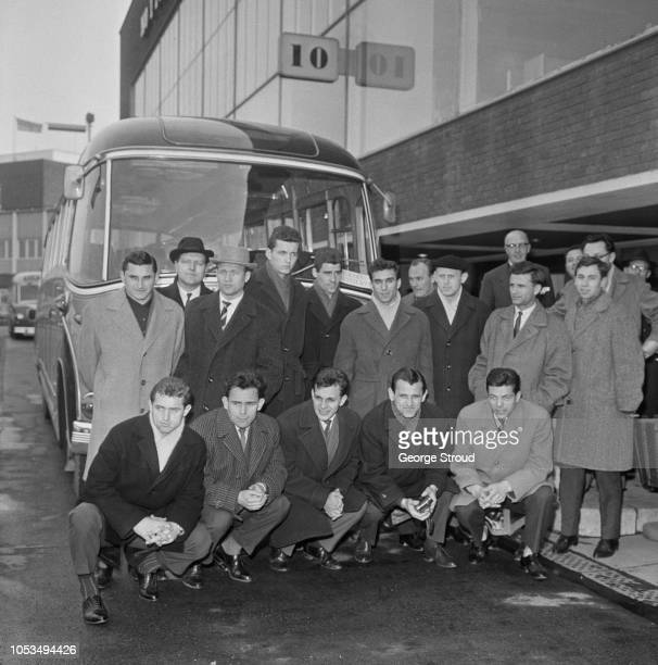 View of the SK Slovan Bratislava football team squad posed together in front of their team coach at London airport after arriving on a flight from...