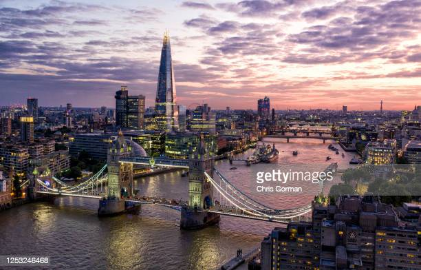 View of the sky line including Tower Bridge and the Shard at dusk on July 14 2019 in London,England.