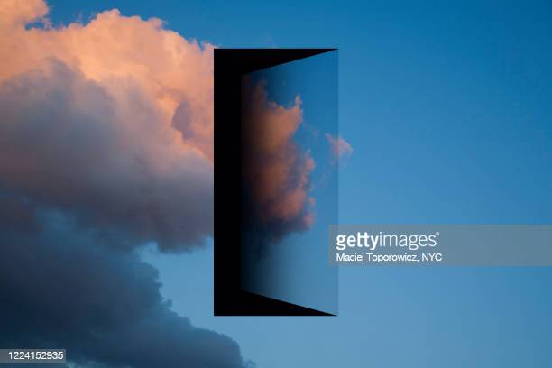 view of the sky with a doorway in it. - escaping stock pictures, royalty-free photos & images