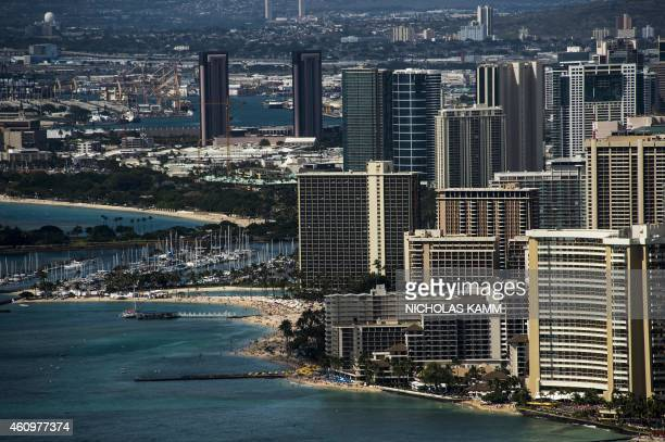 A view of the skyline and the beach of the Waikiki neighborhood of Honolulu on December 31 2014 AFP PHOTO/NICHOLAS KAMM