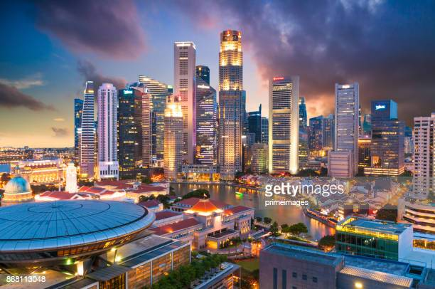 view of the skyline of singapore downtown cbd - singapore flyer stock photos and pictures