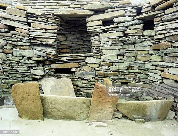 View of the slab built box bed from House 1 UK Neolithic 31002450 BC Skara Brae Orkney Islands
