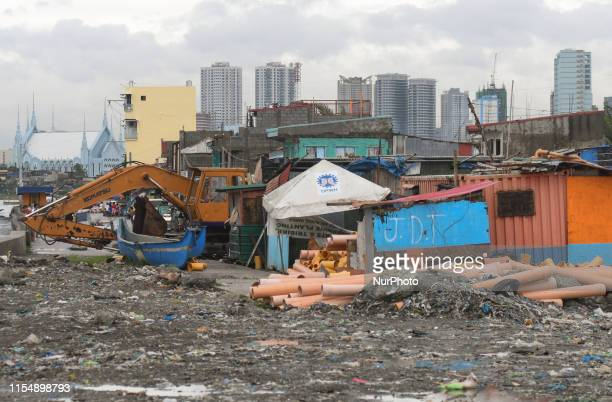 A view of the slams in Baseco Compound and new skyscrapers in Manila downtown The Batangas Shipping and Engineering Company Compound is the largest...