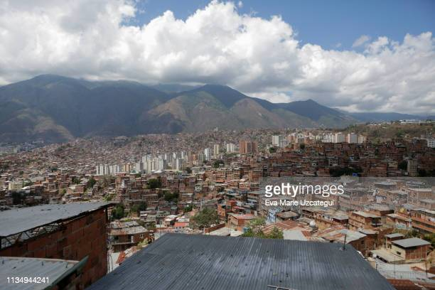 View of the slum of Petare as seen from the home of Eduardo Romero, barber and pastry cook dedicated to the informal economy, on April 4, 2019 in...
