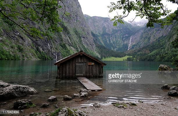 View of the small Obersee lake near Schoenau southern Germany on June 19 in background can be seen the Fischunkealm mountain pasture The lake is...