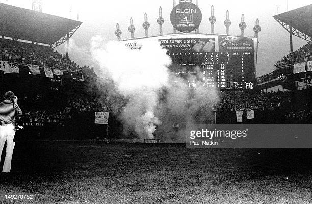 View of the smoke from a huge crate of disco records just prior to its detonation as part of an antidisco promotion at Comiskey Park Chicago Illinois...