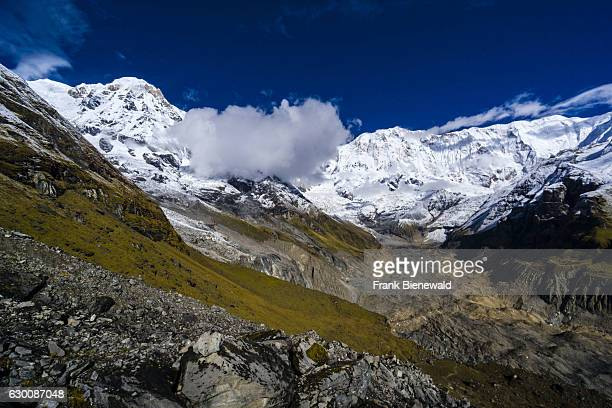 View of the snow covered Annapurna 1 North Face and the Annapurna South summit .