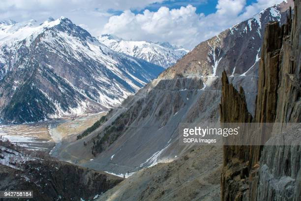View of the snow covered mountains at the snowcleared SrinagarLeh highway in Zojila 108 KM far from Srinagar the summer capital of Indian...