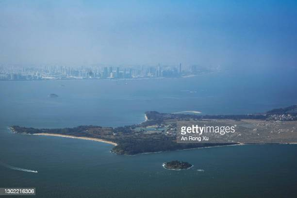 View of the South China Sea between the city of Xiamen in China, in the far distance, and the islands of Kinmen in Taiwan, in the foreground, on...