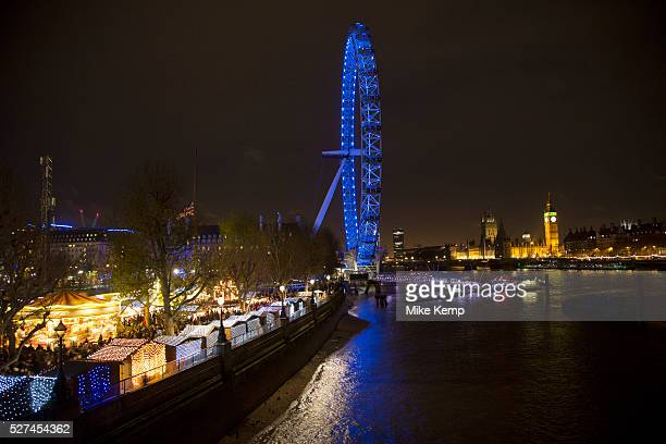 View of the Southbank during the busy Christmas season, towards the London Eye and Westminster across the River Thames. The South Bank is a...