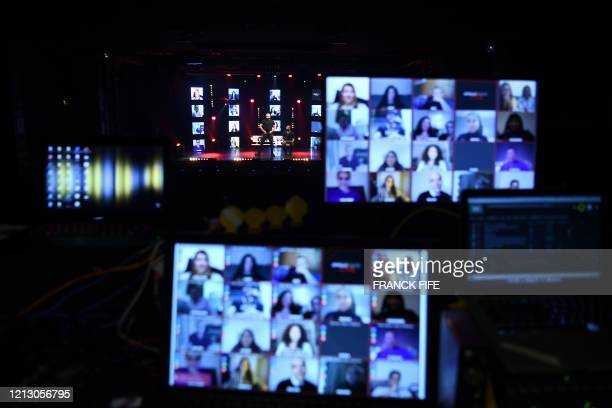 View of the spectators in videoconference during the live streaming show of French humorists Othman and Kalvin at the Apollo Theatre in Paris on May...