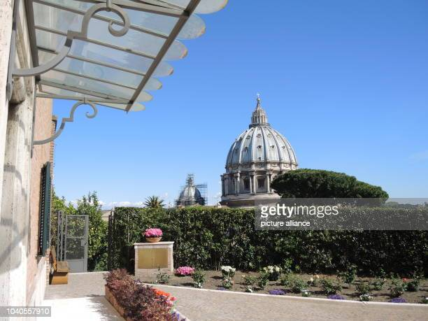 View of the St Peter's Basilica from the entrance to the Mater Ecclesiae Monastery inside the Vatican Gardens in Vatican City 17 April 2017 Pope...