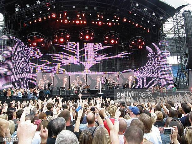 A view of the stage from behind a cheering crowd as Bon Jovi perform on stage on the 'Lost Highway' tour at The Ricoh Arena on June 24th 2008 in...