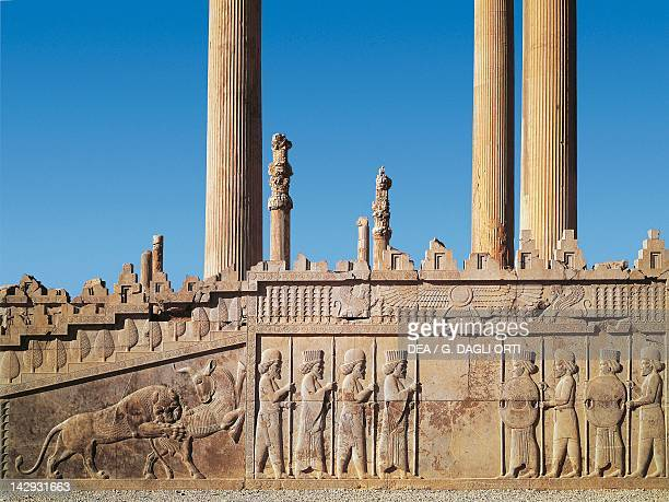 View of the stairs and the basrelief depicting warriors and a bull being attacked by a lion Persepolis Iran Sassanid civilisation 5th Century BC