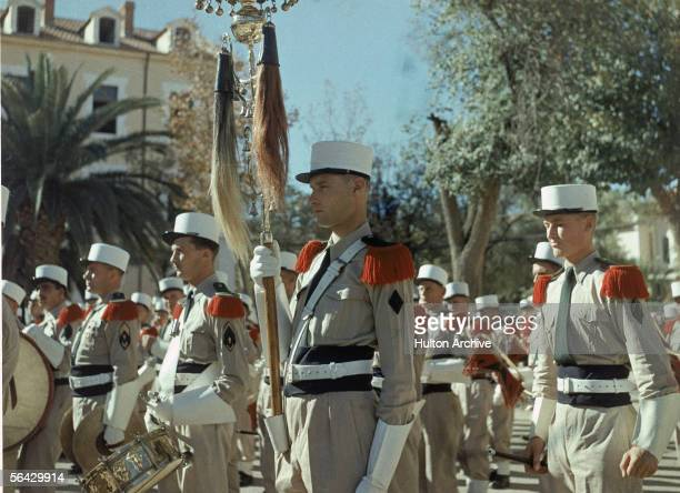 View of the standard bearer in a Foreign Legion parade outside of the Legion's headquarters in Sidi Bel Abbes Algeria 1940s